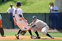 22 May 2010:  FIU's Rudy Flores (11) attempts to catch a pick-off attempt in the fifth inning while FAU's Andy Mee (8) gets back to first safely as the Florida Atlantic University Owls defeated the FIU Golden Panthers, 14-10, at FAU Stadium in Boca Raton, Florida.
