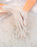 SINGAPORE, Asia, close-up of muddy human hands at Sentosan Spa