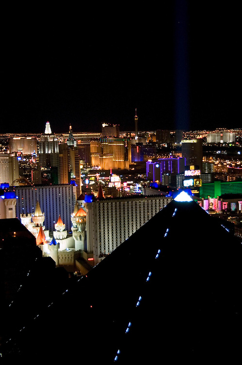 Nevada, NV, Las Vegas, city at night, nightscape, aerial, from Mix Club at Mandalay Bay Hotel, Pyramid of the Luxor Hotel in the foreground, Photo nv253-18711..Copyright: Lee Foster, www.fostertravel.com, 510-549-2202,lee@fostertravel.com
