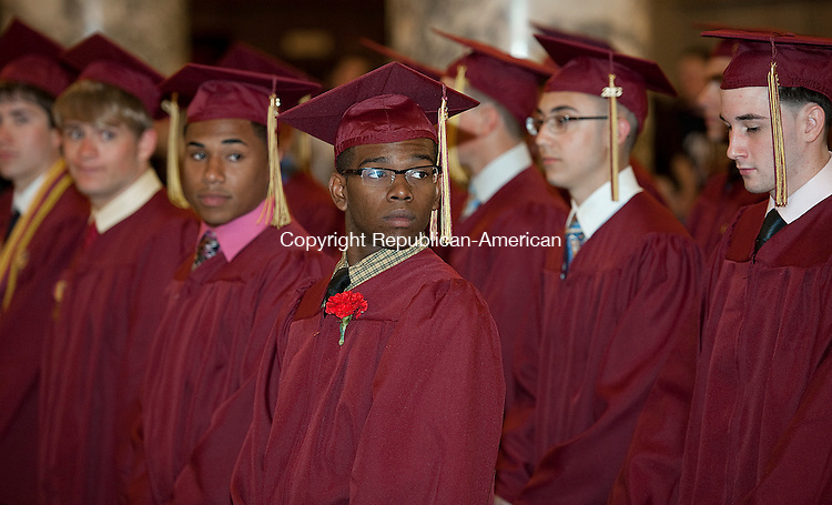 WATERBURY, CT 07 JUNE 2013--060713JS08- Ian Blake, center, watches as fellow graduates file in during the Sacred Heart High School's  87th Commencement Exercises Friday at the Basilica of The Immaculate Conception in Waterbury.<br /> Jim Shannon Republican American