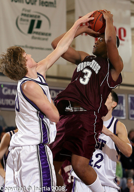 SIOUX FALLS, SD - FEBRUARY 13: David Price #43 of Morningside tries to get a shot off as Dwight Pederson #50 of the University of Sioux Falls gets a hand on the ball in the first half of their NAIA conference game Wednesday night at the Stewart Center in Sioux Falls. (Photo by Dave Eggen/Inertia)