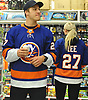 "Anders Lee of the New York Islanders enjoys a cup of coffee as he and Grace Dooley browse the aisles of Toys ""R"" Us in Carle Place for presents during the team's holiday shopping for children in hospitals on Thursday, Nov. 30, 2017. The gifts will be hand-delivered by the players to children in eight local hospitals on Monday, Dec. 18."
