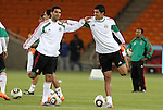 10 JUN 2010: Mexico captain Rafa Marquez (left) stretches with fellow defender Francisco Rodriguez (right). The Mexico National Team held a light practice at Soccer City Stadium in Johannesburg, South Africa the day before playing South Africa in the opening match of the 2010 FIFA World Cup.