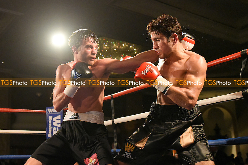 Tommy Tear (black/white shorts) defeats Faheem Khan during a Boxing Show at the Hilton Hotel, Mayfair, England on 11/12/2015