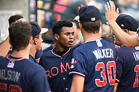 Right fielder Isranel Wilson (20) of the Rome Braves is congratulated after scoring a run in game one of a doubleheader against the Columbia Fireflies on Saturday, August 19, 2017, at Spirit Communications Park in Columbia, South Carolina. Rome won, 8-2. (Tom Priddy/Four Seam Images)