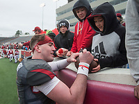 NWA Democrat-Gazette/BEN GOFF @NWABENGOFF<br /> Cole Kelley, Arkansas quarterback, signs autographs for fans Saturday, April 7, 2018, after the Arkansas Red versus White Game at War Memorial Stadium in Little Rock.
