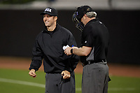 Umpires Ben Sonntag and Rob Healey (right) during a UCF Knights game against the Siena Saints on February 14, 2020 at John Euliano Park in Orlando, Florida.  UCF defeated Siena 2-1.  (Mike Janes/Four Seam Images)