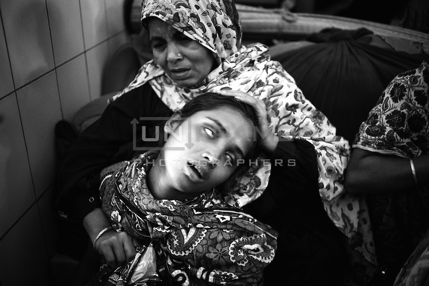 Kohinur (wife of 28 years old Truck Driver Mededi Hassan) mourns for her husband.  Mededi Hassan died at Dhaka Medical College Hospital (DMCH) on 6th December 2013 morning. The 28-year old driver succumbed to his injuries around 9:30am after 7 days of battling death. On November 30, Mehedi received 64 percent burns as pickets hurled a bottle of flammable liquid on his vehicle while he was crossing Harisha Ray area of Faridpur district. After taking the initial treatment at a local hospital, Mehedi was admitted to the burn unit of DMCH.Mehedi Hasan was a man of Kamalapur Village under Kotwali in Faridpur district.  He has left behind two daughters named Mithila and Mim. Dhaka, Bangladesh