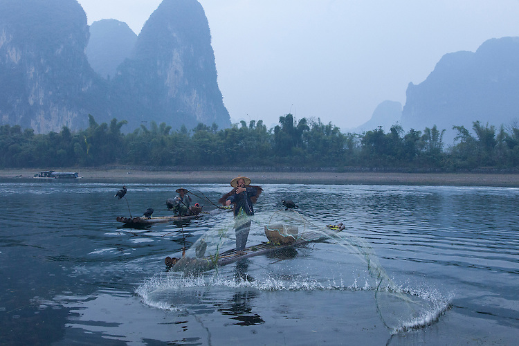 Fisherman on the Li River utilize trained cormorant birds which dive to the river bottom to catch fish.