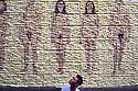 A man loks at an installation by Yann Rabanier at Rue des arens during Les Rencontres de la Photographie in Arles, July 8, 2016. &copy; Carlo Cerchioli<br /> <br /> Un uomo guarda l'installazione di Yann Rabanier esposta a Rue des arens durante i Rencontres de la photographie, Arles, 8 luglio 2016.