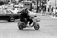 Roma  1985.Ragazze in vespa per le strade di Roma.Vespa girls in the streets of Rome