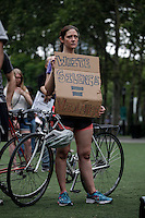 A woman attend a rally for the first anniversary of the death of Eric Garner in Brooklyn New York 07/18/2015. Kena Betancur/VIEWpress
