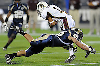 22 November 2008:  FIU linebacker Tyler Clawson (49) tackles Louisiana-Monroe wide receiver J.J. McCoy (1) in the ULM 31-27 victory over FIU at FIU Stadium in Miami, Florida.