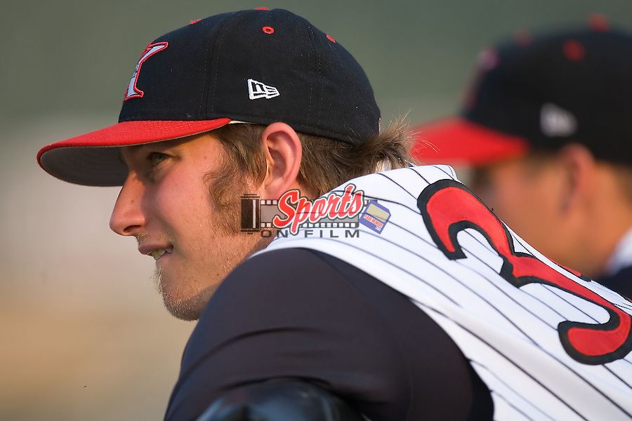 Pitcher Levi Maxwell (39) of the Kannapolis Intimidators watches the game from the top railing of the home dugout at Fieldcrest Cannon Stadium in Kannapolis, NC, Sunday July 20, 2008. (Photo by Brian Westerholt / Four Seam Images)