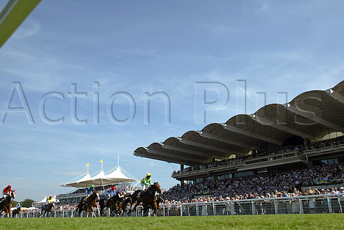 31 July 2004: SEB SANDERS (green) rides PIVOTAL POINT to victory in the Vodafone Stewards Cup at Goodwood Photo: Glyn Kirk/Action Plus...horse racing 040731 flat horses grandstand glorious