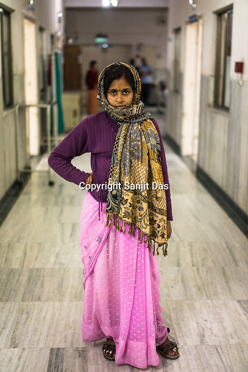 30 year old Kamlesh is a polio patient. Here she poses for a photo outside the Polio Ward of the St. Stephen's Hospital in Delhi, India. Dr. Mathew Varghese is the polio specialist who is providing path breaking technology and making polio patients walk, sometimes first time in their lives.