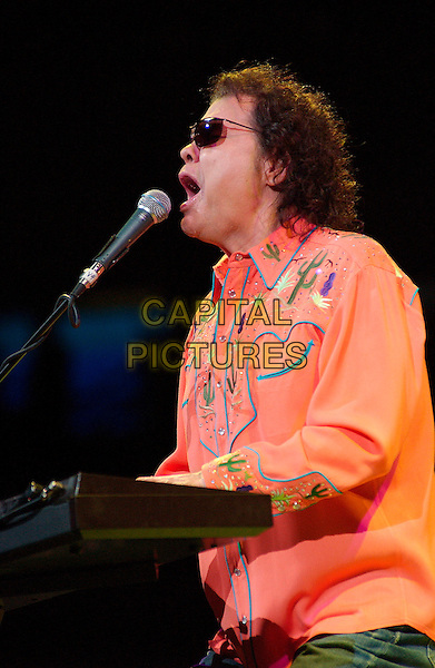RONNIE MISLAP.Country music star RONNIE MILSAP performs as opening act for George Strait's 2007 Tour held at the Mellon Pittsburgh, PennsylvaniaL, USA,.16 February 2007..half length orange shirt keyboard sunglasses concert on stage funny mouth open.CAP/ADM/JN.©Jason L Nelson/AdMedia/Capital Pictures.