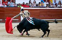 CALI -COLOMBIA-28-12-2013. Faena del torero Español José María Manzanares en la plaza de toros de Cañaveralejo durante la tercera corrida de abono en el marco de la 56 Feria de Cali 2013. Manzanares cortó dos orejas en su segundo toro y salió en hombros./ Faena of spanish bullfighter Jose Maria Manzanares in the bullring Cañaveralejo during the  third bullfight within the framework of 56 Cali Fair 2013. Manzanares cut two ears in his second bull and came out on shoulders Photo: VizzorImage/Juan C. Quintero/STR