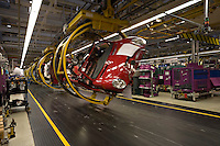 Manufacturing workers producing cars at the BMW Mini plant at Cowley Oxford Oxfordshire UK..©shoutpictures.com..john@shoutpictures.com