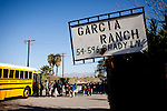 Children file onto the school bus at the Rancho Garcia trailer park in Thermal, Calif., March 9, 2012.