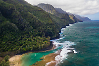 An aerial view of Tunnels Beach, Ha'ena, and the coastline in northern Kaua'i; Mount Makana (nicknamed Bali Hai) is on the right of the mountain range.