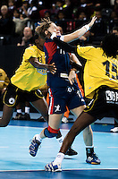 23 NOV 2011 - LONDON, GBR - Britain's Lyn Byl (#11, in blue) finds her way to goal blocked by the Angolan defence during the 2011 London Handball Cup match at The Handball Arena in the Olympic Park in Stratford, London  (PHOTO (C) NIGEL FARROW)