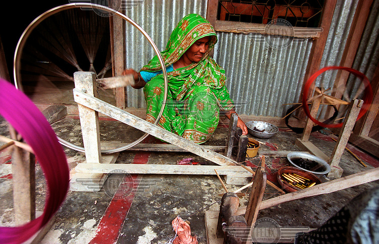 "Sufia Begum turns the wheel of her handloom. She runs a small sari business with the money she borrowed. Grameen Bank, literally meaning ""Bank of the Villages"", is a microfinance organisation and community development bank that issues small loans without requiring collateral. In 2006 Grameen Bank, along with its founder Dr. Mohammad Yunus, were jointly awarded the Nobel Peace Prize ""for their efforts to create economic and social development from below."".."