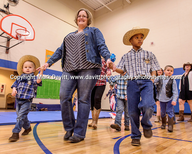 Bondurant hosted a Mother and Son Hoedown March 25 at Anderson Elementary. Everyone had a rootin' tooting' time with lots of snacks, games, crafts, music and dancing too. Alissa Fastenau is escorted by her boys Brayton and Jaydon around the dance floor.