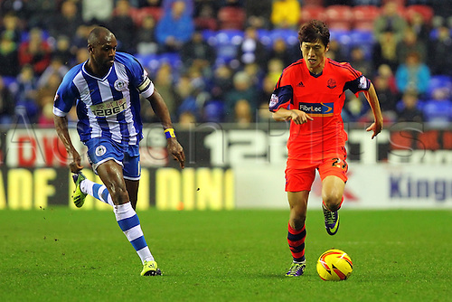 15.12.2013 Wigan, England. Lee Chung-Yong of Bolton Wanderers  in action during the Championship game between Wigan Athletic and Bolton Wanderers from DW Stadium.