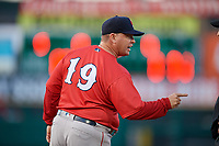 Pawtucket Red Sox manager Kevin Boles (19) argues with first base umpire Travis Godec (not pictured) during a game against the Rochester Red Wings on May 19, 2018 at Frontier Field in Rochester, New York.  Rochester defeated Pawtucket 2-1.  (Mike Janes/Four Seam Images)