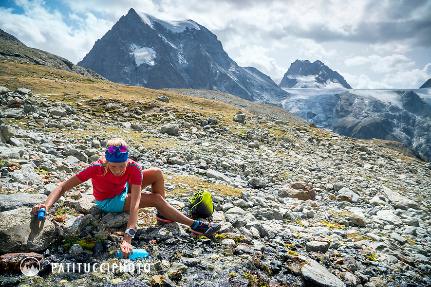 The Chamonix to Zermatt Glacier Haute Route. In late August 2017, we ran the tour in mountain running gear, running shoes, and all the necessary glacier travel and crevasse rescue gear. Taking a break to filter water and hydrate while on the way to the Bertol Hut.