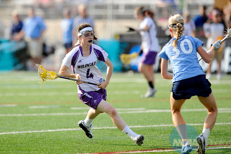 24 MAY 2009: Katrina Dowd (4) of Northwestern and Mia Hurrin (30) of North Carolina battle for the ball during the Division I Women's Lacrosse Championship held at Johnny Unitas Stadium on the Towson University campus in Towson, MD. Northwestern defeated UNC 21-7 for the national title. Greg Fiume/NCAA Photos