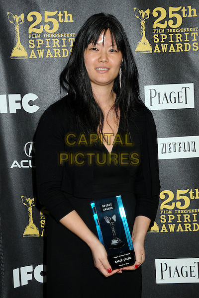 KARIN CHIEN .25th Annual Film Independent Spirit Awards - Press Room held at the Nokia Event Deck at L.A. Live, Los Angeles, California, USA, 5th March 2010..indie half length trophy award winner  black smiling .CAP/ADM/BP.©Byron Purvis/AdMedia/Capital Pictures.