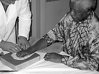 BNPS.co.uk (01202 558833)<br /> Pic: Guernseys/BNPS<br /> <br /> The casts being made in 2002.<br /> <br /> A set of four remarkably detailed gold casts of Nelson Mandela's hands have emerged for sale for £7.5million. ($10million)<br /> <br /> They were made out of pure gold in 2002 and initially sold to raise funds for the Nelson Mandela Children's Fund.<br /> <br /> Two of the casts show his fists, while the others are of his open palms. <br /> <br /> They show the scars of his 26 years imprisoned on Robben Island.