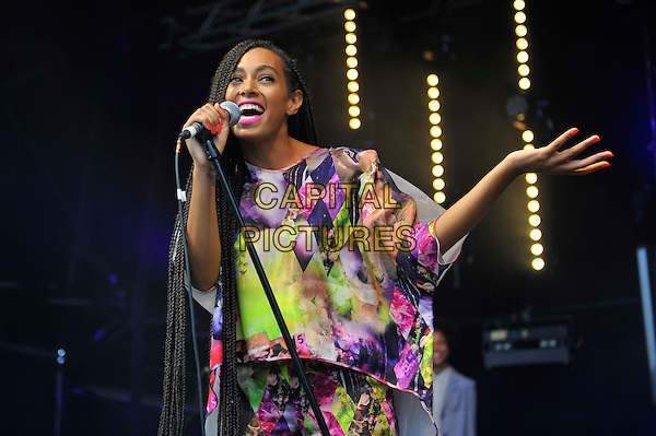 Solange (Solange Knowles) <br /> performing at Glastonbury Festival, Worthy Farm, Pilton, Somerset, <br /> England, UK, 28th June 2013.<br /> half length music gig concert gig live on stage singing long hair braids singing microphone  hand pink yellow white print catsuit jumpsuit top <br /> CAP/MAR<br /> &copy; Martin Harris/Capital Pictures