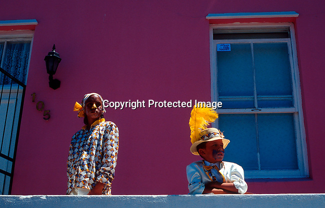 """dippcoo00058 .People. Coons.  Cape Minstrels CAPE TOWN, SOUTH AFRICA - JANUARY 2: Unidentified participans taking a break in Bo-Kaap, a muslim area during the yearly """"Coon Carnival"""" on January 2, 2003 in Cape Town, South Africa. The carnival performers are primarily mixed-race, or colored people and the carnival began in the early 19th century when slave bands played friendly competition during the annual Jan. 2 slave holiday. The parade has become a popular tourist attraction and the colorful floats are competing at a local stadium for days for the best costumes and performances..©Per-Anders Pettersson/ iAfrika Photos.."""