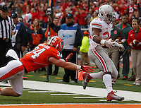 Ohio State Buckeyes running back Carlos Hyde (34) evades Illinois Fighting Illini linebacker Mike Svetina (34) to score a touchdown in the second quarter during Saturday's NCAA Division I football game at Memorial Stadium in Champaign, Il., on November 16, 2013. Ohio State led at halftime with a score of 35-14. (Barbara J. Perenic/The Columbus Dispatch)