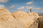 A line of petrified sand dunes turns into a playground for the fit and adventurous. Paria Plateau, AZ<br /> <br /> For more Adventure photos please check out my Get Out There Gallery!