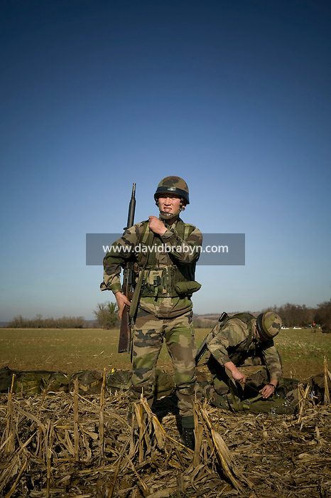 Member of the French Foreign Legion Wang from China waits for his comrades at their gathering point after jumping over a plain north of Tarbes, France, during a full scale multi-force exercise, 12 December 2007.