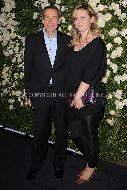 WWW.ACEPIXS.COM . . . . . .April 25, 2011...New York City...Jeff Koons and Justine Koos attend the Chanel Tribeca Film Festival artists dinner at The Odeon on April 25, 2011  in New York City....Please byline: KRISTIN CALLAHAN - ACEPIXS.COM.. . . . . . ..Ace Pictures, Inc: ..tel: (212) 243 8787 or (646) 769 0430..e-mail: info@acepixs.com..web: http://www.acepixs.com .