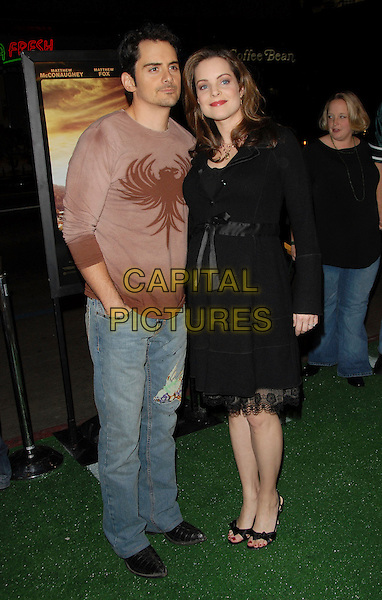 "BRAD PAISLEY & KIMBERLY WILLIAMS PAISLEY.Warner Brothers Pictures World Premiere of ""We are Marshall"" held at The Grauman's Chinese Theatre in Hollywood, California, USA. .December 14th, 2006.full length black dress brown top couple lace.CAP/DVS.©Debbie VanStory/Capital Pictures"