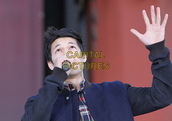 Harry Shum Jr.Grauman's Chinese hand and foot print ceremony for the late Michael Jackson, celebrating the Los Angeles debut of Michael Jackson THE IMMORTAL World Tour by Cirque du Soleil held at Grauman's Chinese Theatre, Hollywood, California, USA..January 26th, 2012.half length hand arm singing stage performance music gig live blue jacket check shirt .CAP/ADM/KB.©Kevan Brooks/AdMedia/Capital Pictures.