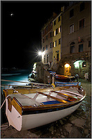 Sometimes at night in the Cinque Terre, boats are pulled up into the tiny harbors to await their next excursion. In the sleepy village of Riomaggiore, a  stroll at night is peaceful with the waves of the Ligurian Sea lapping up onto the boat ramp and rocky coastline.