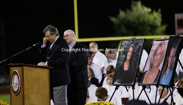 CHESHIRE, CT 9/19/07- 091907BZ17- Dr. William Petit Jr. wipes his eye while addressing hundreds who turned out for a town-wide memorial for his family at Cheshire High School Wednesday night.  Petit's wife Jennifer Hawke-Petit and their two daughters Hayley and Michaela were murdered during a home invasion.  Standing behine Petit is pastor Rev. Stephen Volpe.<br /> Jamison C. Bazinet Republican-American