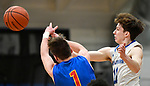 Alton Marquette guard Spencer Cox (right) knocks the ball away from Roxana guard Drew Beckman. Alton Marquette played Roxana in the Class 2A Roxana boys basketball regional final at Roxana High School in Roxana, Illinois on Friday February 28, 2020. <br /> Tim Vizer/Special to STLhighschoolsports.com