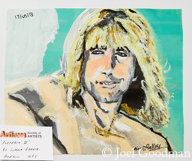"© Joel Goodman - 07973 332324 . 23 August 2013 . Barge on Bridgewater Canal , moored in Oughtrington , Cheshire , UK . Art work exhibited on the barge - portrait of Rick Parfitt off of Status Quo by Joanna Barker. Gallery curator Dave Clarke (67) (from Altrincham) (correct) on a barge which he has bought and adapted to form a floating art gallery called "" Artism "" , exhibiting the work of autistic artists . Photo credit : Joel Goodman"