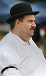 "The arbiter - the forerunner of the modern baseball umpire - watches play during a game on August 4, 2012 at the Swansea Moose Lodge fields between the Belleville Stags and the St. Louis Unions. He is portrayed by ""Judge David P. Showmaker"" who wears authentic period attire for the games, including an original derby from the late 19th century which the team bought off eBay for him. The teams played by rules of the game as they were in the late 19th century -- when there were no umpires, only a lone arbiter to make judgement calls."
