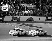 Dale Earnhardt (#3) chases Geoff Bodine in the 1986 Daytona 500 at Daytona International Speedway.  Bodine won the race while Earnhardt finished 14th after running out of gas.(Photo by Brian Cleary)