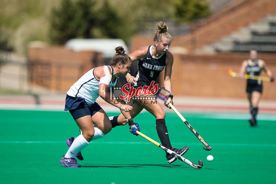 Emily Adamson (9) of the Wake Forest Demon Deacons battles for the ball with Hannah Jones (8) of the Liberty Flames during first half action at Kentner Stadium on September 20, 2015 in Winston-Salem, North Carolina.  The Demon Deacons defeated the Flames 2-1.  (Brian Westerholt/Sports On Film)