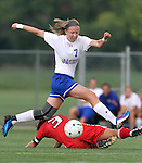 BROOKINGS, SD - AUGUST 16:  Diana Potterveld #7 from South Dakota State University leaps while controlling the ball past Laura Carroll #3 from Winnipeg in the first half of their game Friday evening at Fischback Soccer Field in Brookings. (Photo by Dave Eggen/Inertia)